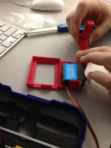 Fitting the Servo into the holder.